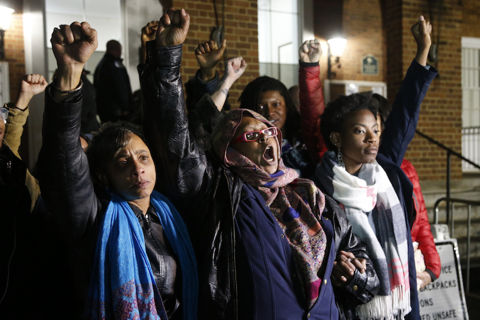 "Activists raise their fists outside Charlottesville General District Court after a guilty verdict was reached in the trial of James Alex Fields Jr., in Charlottesville, Va., Friday, Dec. 7, 2018. Fields was convicted of first degree murder in the death of Heather Heyer as well as nine other counts during a ""Unite the Right"" rally in Charlottesville . (AP Photo/Steve Helber)"
