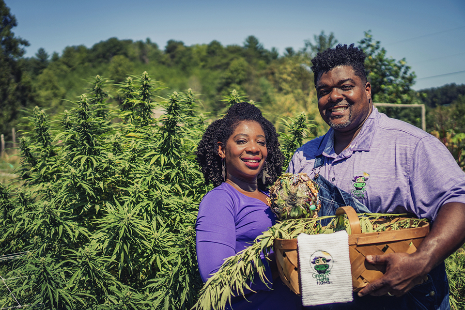 "In this September 2018 photo provided by Clarenda ""Cee"" Stanley-Anderson, Stanley-Anderson and her husband, Malcolm Anderson Sr., pose for pictures of their hemp-farming business, Green Heffa Farms, Inc., in Liberty, N.C. Hemp is about to get the federal legalization that marijuana, its cannabis cousin, craves. That unshackling at the national level sets the stage for greater expansion in an industry seeing explosive growth through demand for CBDs, the non-psychoactive compound in hemp that many see as a way to better health. (Donald Rex Bishop/Green Heffa Farms, Inc. via AP)"
