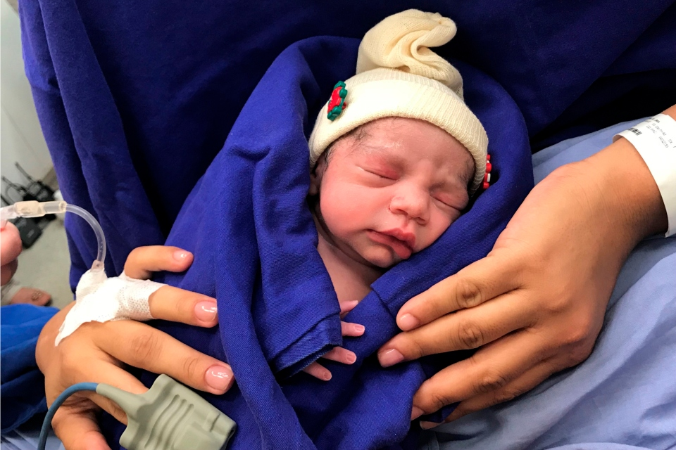 This Dec. 15, 2017 photo provided by transplant surgeon Dr. Wellington Andraus shows the baby girl born to a woman with a uterus transplanted from a deceased donor at the Hospital das Clinicas of the University of Sao Paulo School of Medicine, Sao Paulo, Brazil, on the day of her birth. Nearly a year later, mother and baby are both healthy. (Courtesy Dr. Wellington Andraus via AP)