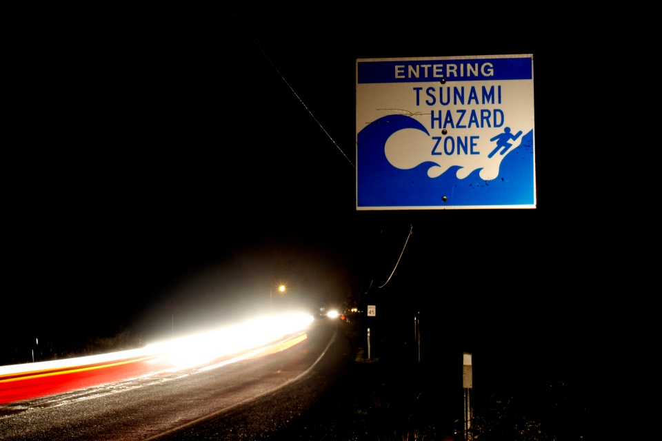 In this March 11, 2011, file photo, car headlights from a steady stream of cars form a line as residents evacuate the coastal town of Seaside, Ore., after the warning of a tsunami surge from a Japanese earthquake was issued. Oregon has a new playbook for preparing and responding to a major earthquake that dictates what should be tackled over time versus a list of tasks to get done. (AP Photo/Don Ryan, File)