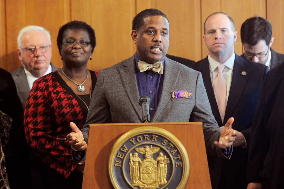 In this Feb. 6, 2017, file photo, Sen. Kevin Parker, D- Brooklyn, stands at the podium, flanked by Senate members during a news conference at the Capitol in Albany, N.Y. Parker wants to require police to scrutinize social media activity and online searches of handgun license applicants, and disqualify those who make violent or hateful posts. The bill's fate is uncertain amid questions from free-speech advocates. (AP Photo/Hans Pennink, File)