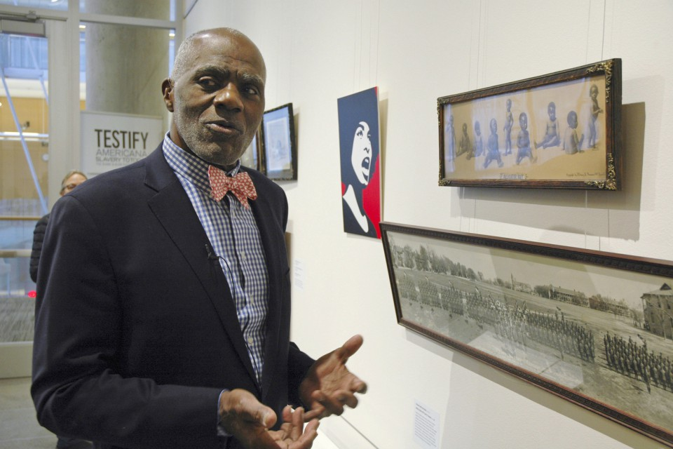 "Alan Page, NFL Hall of Famer and retired Minnesota Supreme Court justice, stands in Minneapolis. by a photo of black babies labeled ""Alligator Bait."" (AP Photo/Steve Karnowski)"