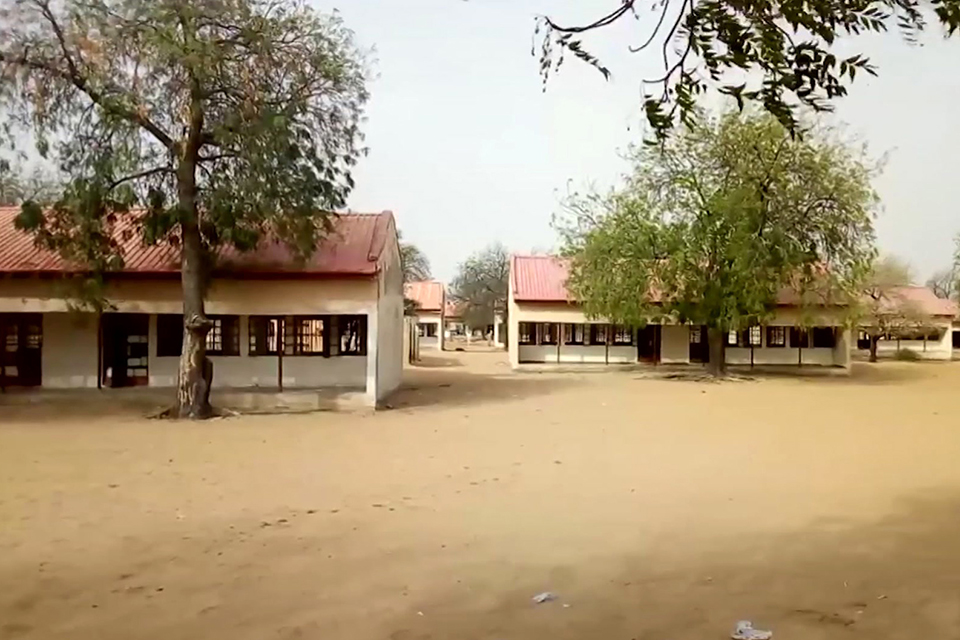 This image taken from video shows the exterior of Government Girls Science and Tech College in Dapchi, Yobe State, Nigeria on Feb. 22. Parents in northern Nigeria say more than 100 girls are still missing three days after suspected Boko Haram extremists attacked their school. The announcement comes after government officials in Yobe state acknowledged that some 50 young women remained unaccounted for in the Monday evening attack. (AP Photo)