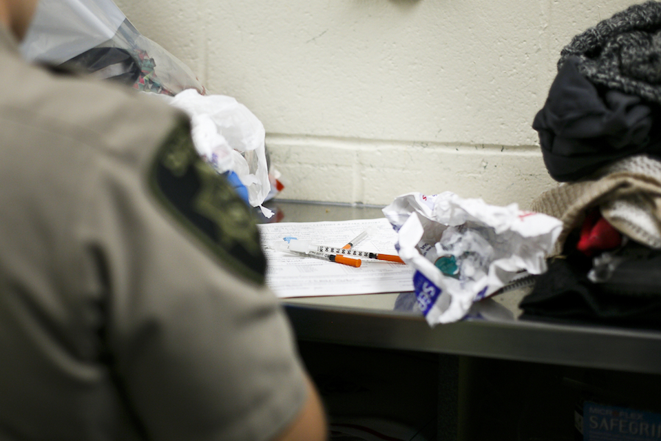 Deputies find needles and drug paraphernalia on an incoming detainee at the Marion County Jail, June 23, 2017. Meth-related deaths are higher now than they've ever been in Oregon, far surpassing the rates seen at the height of the meth crisis in the mid-2000s. (Molly J. Smith/Statesman-Journal via AP)