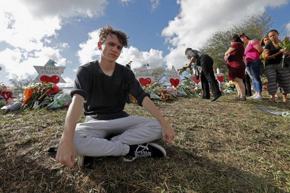 ChrisGrady and his friend are among about 100 Stoneman Douglas students who are heading to Florida's capital, Tallahassee, to push lawmakers to do something to stop gun violence. (AP Photo/Gerald Herbert)