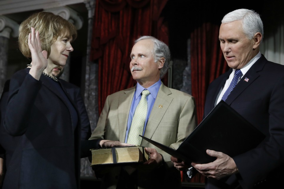 Vice President Mike Pence, right, administers the Senate oath of office during a mock swearing in ceremony in the Old Senate Chamber to Sen. Tina Smith, D-Minn (AP Photo/Jacquelyn Martin)