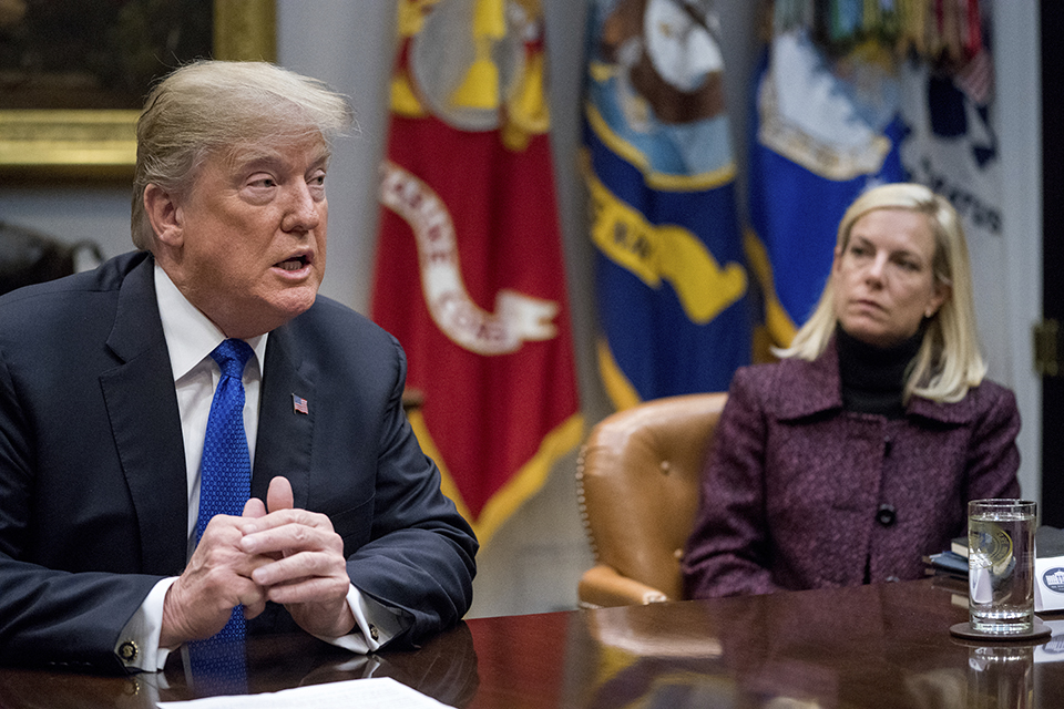 In this Thursday, Jan. 4, 2018, file photo, President Donald Trump, accompanied by Secretary of Homeland Security Kirstjen Nielsen, right, speaks during a meeting with Republican Senators on immigration in the Roosevelt Room at the White House in Washington.