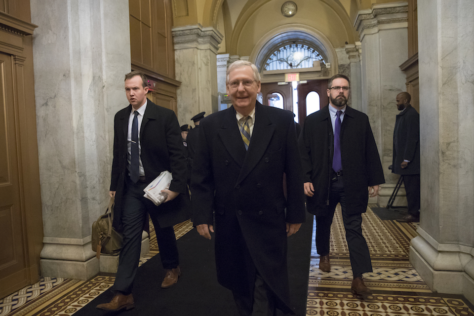 Senate Majority Leader Mitch McConnell, R-Ky., arrives at the Capitol in Washington, Friday, Jan. 19, 2018, as a bitterly-divided Congress hurtles toward a government shutdown this weekend in a partisan stare-down over demands by Democrats for a solution on politically fraught legislation to protect about 700,000 younger immigrants from being deported. (AP Photo/J. Scott Applewhite)