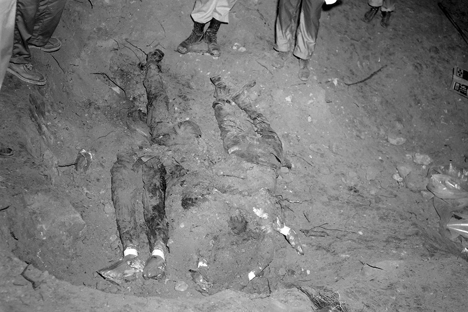 In this 1964 file photo released by the FBI, the bodies of three civil rights workers are uncovered from an earthen dam southwest of Philadelphia, Miss.