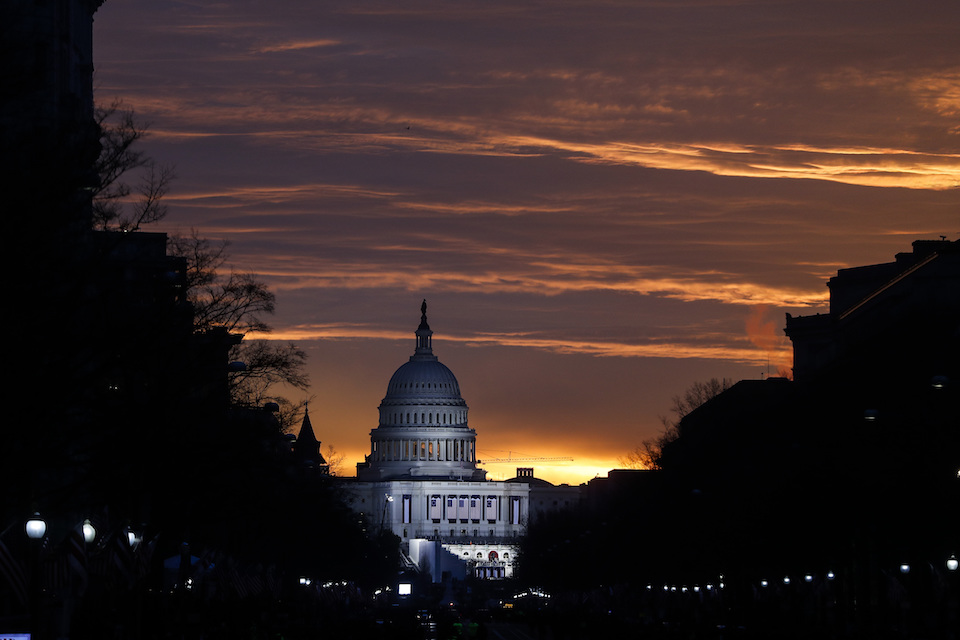 The U.S. Capitol Building is illuminated during sunrise in Washington, Friday, Jan. 20, 2017. The same Russian government-aligned hackers who penetrated the Democratic Party have spent the past few months laying the groundwork for an espionage campaign against the U.S. Senate, the cybersecurity firm Trend Micro said Friday, Jan. 12, 2018. (AP Photo/John Minchillo)