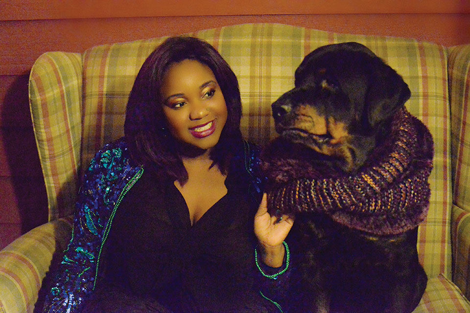 Dr. Jasmine Streeter, Veterinarian relaxes with her dog Sheba.