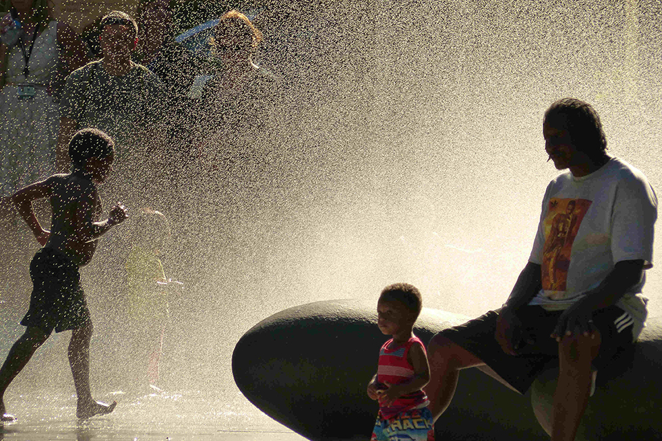 Kids and parents at Dawson Park splash pad in Portland, Oregon
