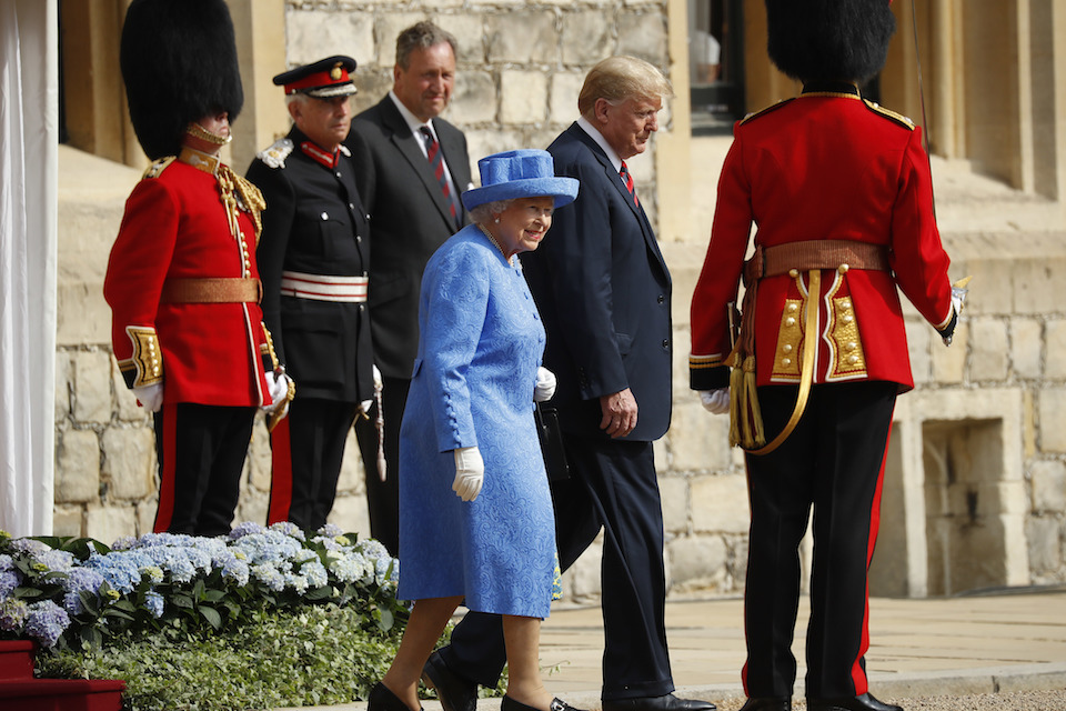 Queen Elizabeth II and President Donald Trump walk together to inspect the Guard of Honour at Windsor Castle in Windsor, England, Friday, July 13, 2018. (AP Photo/Pablo Martinez Monsivais)