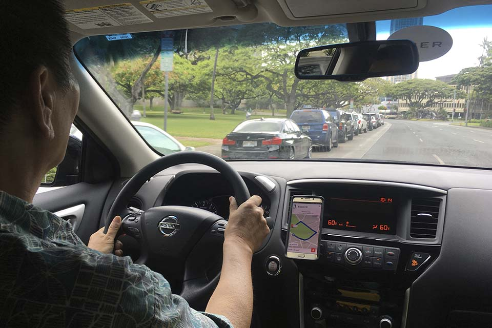Uber driver Joshua Oh drives in Honolulu on June 6. A new government report says the number of independent workers hasn't budged that much over the last decade – but experts say it contains notable limitations. (AP Photo/Jennifer Sinco Kelleher)
