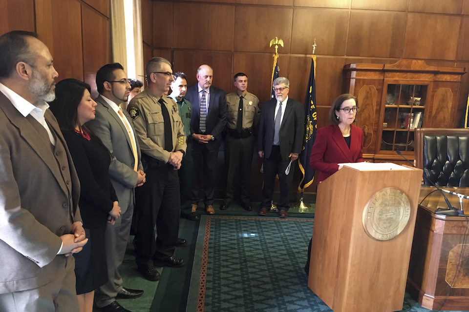 Oregon Gov. Kate Brown speaks during a news conference in the Capitol ceremonial office in Salem, Ore. Feb. 2, 2017. Brown is asking Oregon's attorney general to bring legal action against the federal government over President Donald Trump's executive order on immigration. A conservative group is taking aim at the nation's oldest statewide sanctuary law, with a drive to repeal a 31-year-old Oregon mandate limiting police coordination on immigration arrests. (AP Photo/Andrew Selsky, File)