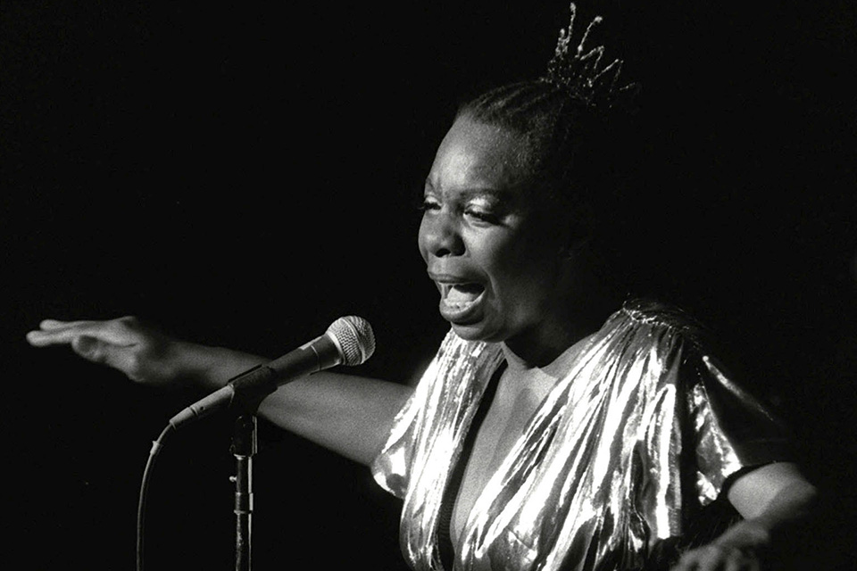 In this June 27, 1985, file photo, Nina Simone performs at Avery Fisher Hall in New York. The dilapidated wooden cottage in North Carolina that was the birthplace of singer and civil rights activist Nina Simone now has the protection of the National Trust for Historic Preservation. The trust said in a news release Tuesday, June 19, 2018, that it will develop and find a new use for the house in Tryon where Simone was born in 1933. (AP Photo/Rene Perez, File)