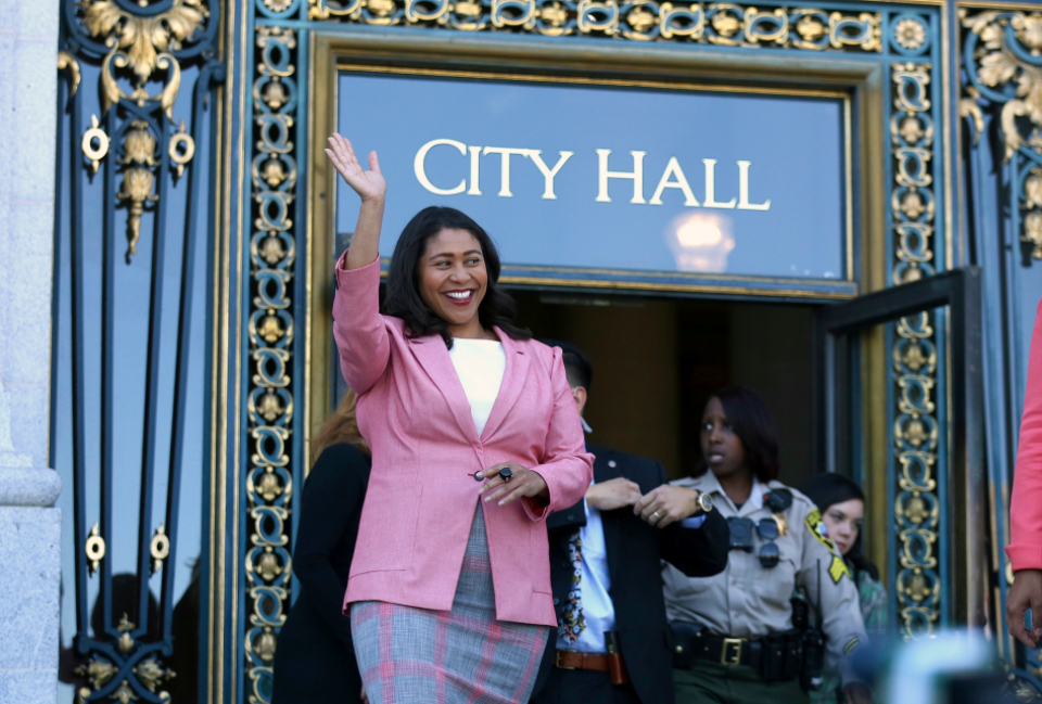 London Breed waves before speaking to reporters outside of City Hall in San Francisco, Wednesday, June 13, 2018. (AP Photo/Lorin Eleni Gill)