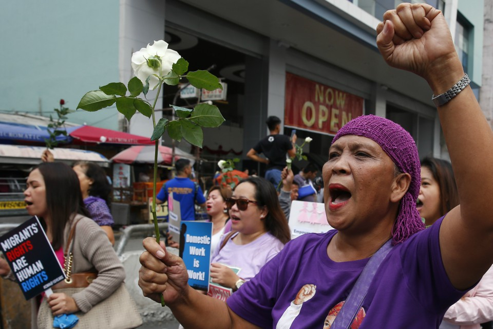 Protesters shout slogans as they march towards a Manila square for a rally to mark International Women's Day Thursday, March 8, 2018 in Manila, Philippines (AP Photo/Bullit Marquez)