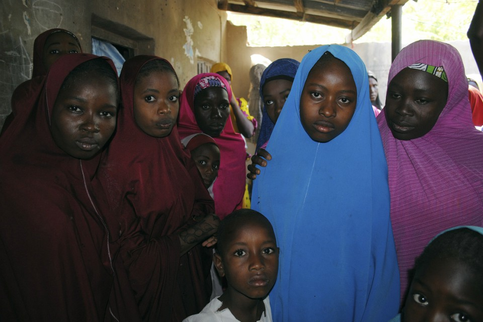 Witnesses say Boko Haram militants have returned an unknown number of the 110 girls who were abducted from their Nigeria school a month ago. (AP Photo/Jossy Ola)