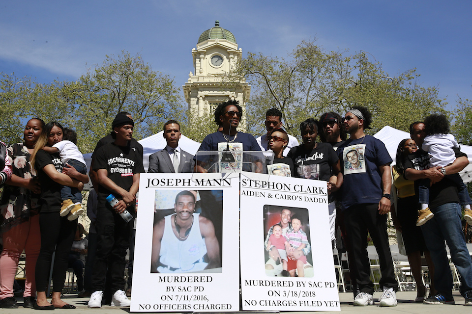 Curtis Gordon, center, the uncle of Stephon Clark, speaks at a rally aimed at ensuring Clark's memory and calling for police reform, Saturday, March 31, 2018, in Sacramento, Calif. The gathering comes nearly two weeks after Clark, who was unarmed, was shot and killed by two Sacramento police officers. (AP Photo/Rich Pedroncelli)