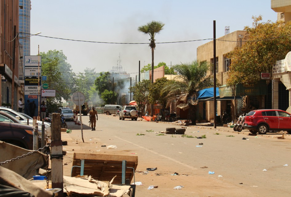 Gunfire and explosions rocked Burkina Faso's capital early Friday in what the police said was a suspected attack by Islamic extremists (AP Photo/ Ludivine Laniepce)