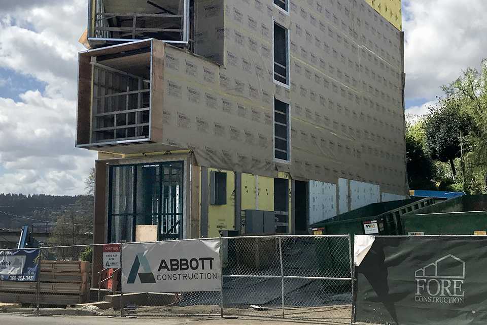 This April 21 photograph depicts a building under construction on N. Missisippi Ave. Rents in newly constructed buildings fell in 2017 for the first time in years, according to the city's recently-released State of Housing report – but renters of color are still unable to afford rent in any neighborhood in the city. Photo by A. Davey (CC BY-NC-ND 2.0) via Flickr.