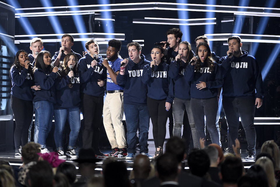 Khalid, seventh from left, and Shawn Mendes, fifth from right, perform