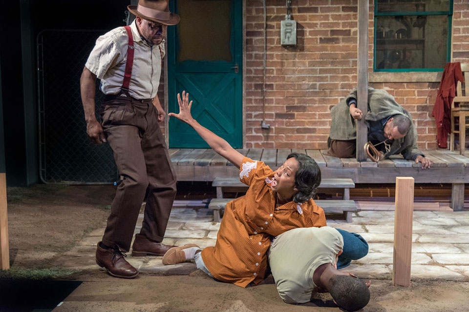 Lester Purry (Troy Maxson), Erika LaVonn (Rose Maxson), and La'Tevin Alexander (Cory Maxson) in Portland Playhouse's production of 'Fences' (Photo courtesy of Portland Playhouse)