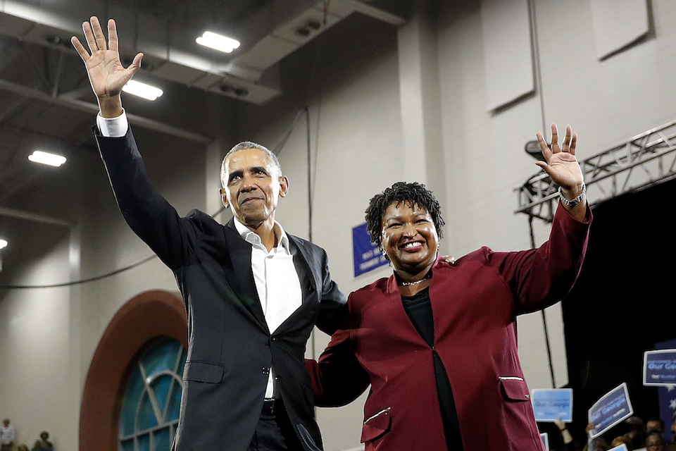 Former President Barack Obama and Democratic candidate for Georgia Governor Stacey Abrams wave to the crowd during a campaign rally at Morehouse College Friday, Nov. 2, 2018, in Atlanta. (AP Photo/John Bazemore)