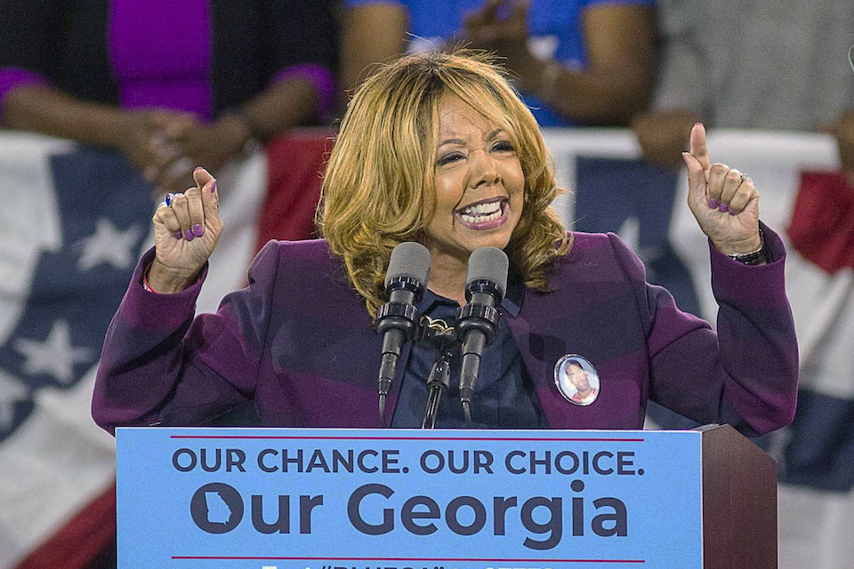 Democrat Lucy McBath speaks during a rally for Democratic gubernatorial candidate Stacey Abrams, at Morehouse College in Atlanta. Republican Rep. Karen Handel faced and GOP Rep. Rob Woodall faces a risk of losing their seats Wednesday, Nov. 7, 2018, as election returns showed them in perilously tight races with Democratic challengers in a pair of suburban Atlanta districts long considered safe for the GOP. (Alyssa Pointer/Atlanta Journal-Constitution via AP, File)