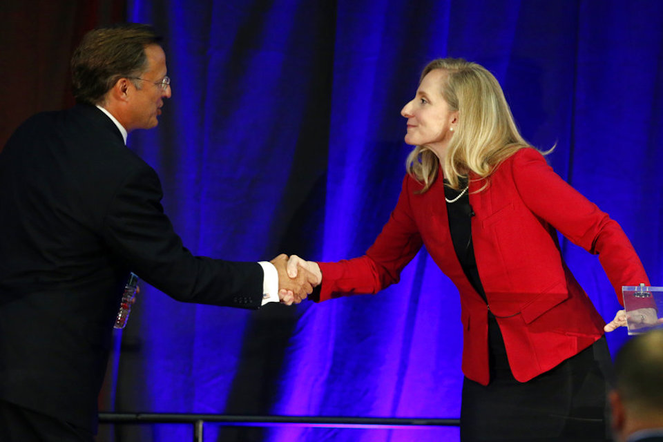 Virginia Congressman Dave Brat, R-Va., left, shakes hands with Democratic challenger Abigail Spanberger, right, after a debate at Germanna Community College in Culpeper, Va. Oct. 15, 2018. The path to power in the House runs through a few dozen districts in Tuesday's election, with Republicans defending their majority and Democrats looking to gain 23 seats they would need to win control. (AP Photo/Steve Helber)