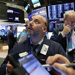 In this Friday, Nov. 9, 2018, file photo trader Vincent Napolitano, left, works on the floor of the New York Stock Exchange. The U.S. stock market opens at 9:30 a.m. EDT on Tuesday, Nov. 20. (AP Photo/Richard Drew, File)