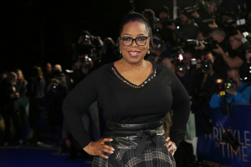 "In this March 13, 2018, file photo, actress Oprah Winfrey poses for photographers upon arrival at the premiere of the film 'A Wrinkle In Time' in London. Winfrey has chosen Michelle Obama's ""Becoming"" as her next book club pick, The Associated Press has learned. In a statement Monday, Nov. 12, Winfrey said the memoir was ""well-written"" and inspirational. (Photo by Joel C Ryan/Invision/AP, File)"