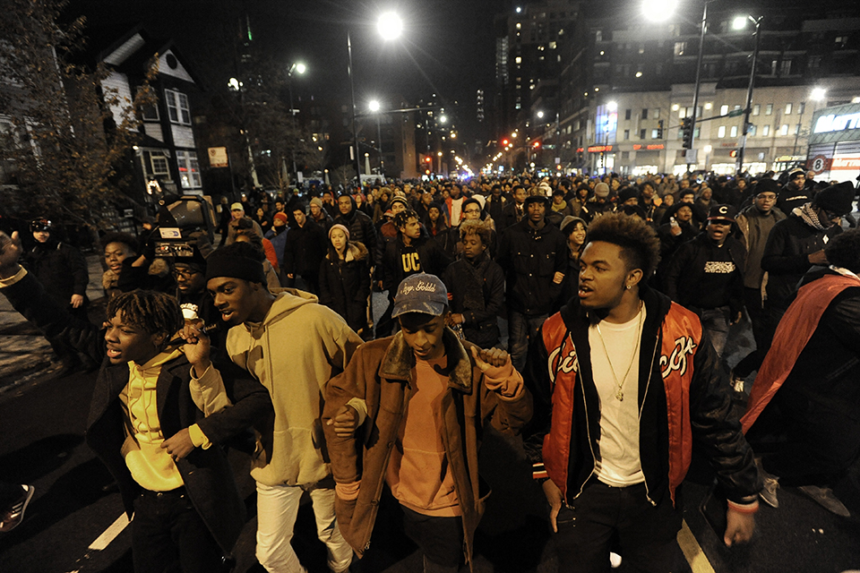 In this Nov. 24, 2015 file photo, marchers protest the police shooting of 17-year-old Laquan McDonald, in Chicago. The city of Chicago is watching closely for word of a verdict in the case of Chicago Police Officer Jason Van Dyke charged with murder in the 2014 shooting of McDonald. The Chicago Police Department has canceled days off and put officers on 12-hour shifts. (AP Photo/Paul Beaty, File)