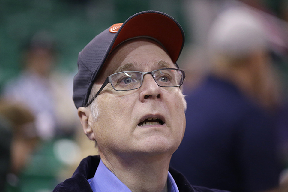 In this Oct. 12, 2015 file photo, Portland Trail Blazers owner Paul Allen looks on before the start of the first quarter of an NBA preseason basketball game against the Utah Jazz in Salt Lake City. Allen, billionaire owner of the Trail Blazers and the Seattle Seahawks and Microsoft co-founder, died Monday, Oct. 15, 2018 at age 65. Earlier this month Allen said the cancer he was treated for in 2009, non-Hodgkin's lymphoma, had returned. (AP Photo/Rick Bowmer, File)