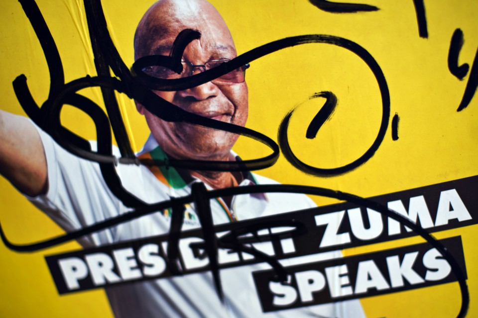 An election poster of President Jacob Zuma is defaced in the downtown area of Johannesburg, South Africa (AP Photo/Ben Curtis, File)