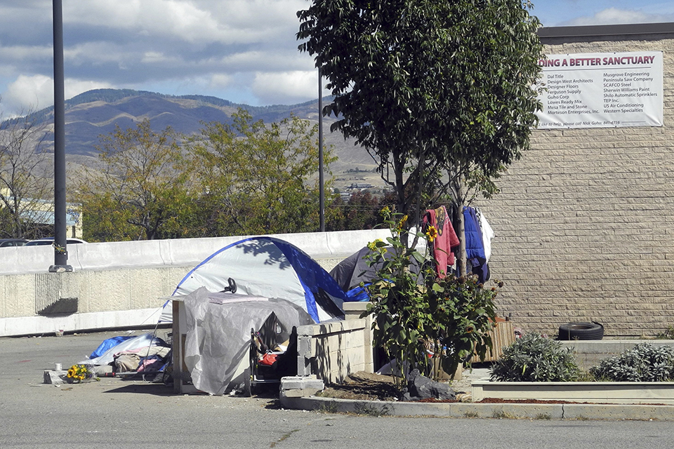This undated file photo shows the entrance to an alley known as Cooper Court, a homeless camp in Boise, Idaho. A federal appellate court says cities can't prosecute people for sleeping on the streets if they have nowhere else to go. In a ruling handed down Tuesday, Sept. 4, 2018, the 9th U.S. Circuit Court of Appeals sided with six homeless Boise, Idaho residents who sued the city in 2009 alleging that a local ordinance that bans sleeping on the streets amounted to cruel and unusual punishment. The ruling could impact several other cities across the western U.S.(Adam Cotterell/Boise State Public Radio via AP, File)