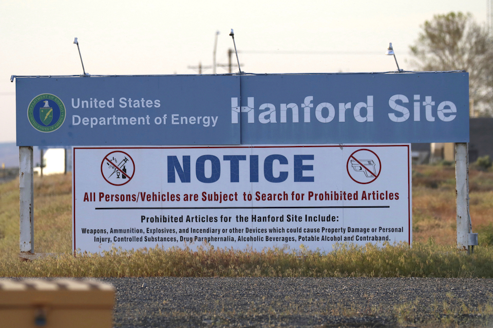 Signs are posted at a entrance to the Hanford Nuclear Reservation in Richland, Wash. May 9, 2017. Washington state officials are criticizing the administration of President Donald Trump for the slow pace of cleaning up the nation's largest cache of radioactive waste left over from the production of nuclear weapons. The U.S. Department of Energy recently proposed budget cuts for cleaning up the Hanford Nuclear Reservation even though the estimated cost of the cleanup has at least tripled in recent years. (AP Photo/Manuel Valdes, File)