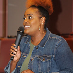 Nichole Watson speaks at an April 13 forum on upcoming school board races
