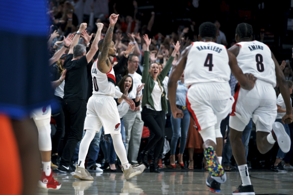 Portland Trail Blazers guard Damian Lillard reacts after making the game-winning shot at the buzzer against the Oklahoma City Thunder in Game 5 of an NBA basketball first-round playoff series, Tuesday, April 23, 2019, in Portland, Ore. The Trail Blazers won 118-115. (AP Photo/Craig Mitchelldyer)
