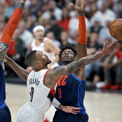 Portland Trail Blazers guard Damian Lillard, left, shoots by Oklahoma City Thunder forward Jerami Grant during the first half of Game 5 of an NBA basketball first-round playoff series, Tuesday, April 23, 2019, in Portland, Ore. (AP Photo/Craig Mitchelldyer)
