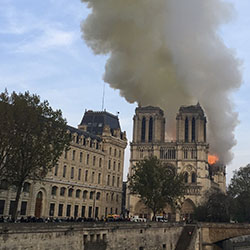 Notre Dame cathedral is burning in Paris, Monday, April 15, 2019. Massive plumes of yellow brown smoke is filling the air above Notre Dame Cathedral and ash is falling on tourists and others around the island that marks the center of Paris. Notre Dame cathedral is burning in Paris, Monday, April 15, 2019. Massive plumes of yellow brown smoke is filling the air above Notre Dame Cathedral and ash is falling on tourists and others around the island that marks the center of Paris. (AP Photo/Lori Hinant)