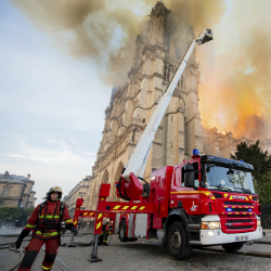 Fire fighters working at the burning Notre Dame cathedral, Monday April 15, 2019. (Benoit Moser, BSPP via AP)