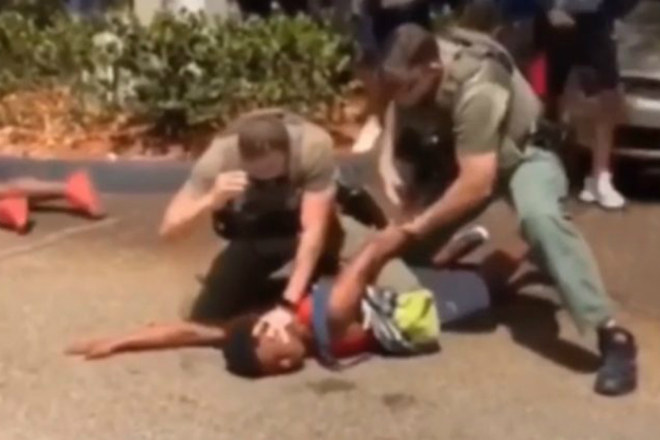 A cell phone video captured Broward County Sheriff's deputies pepper-spraying, tackling and punching a group of teens last week outside a McDonald's near the school. (Photo Courtesy: NNPA)