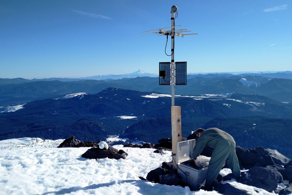 Pacific Northwest Seismic Network technician working at station HSR on the south flank of Mount St. Helens. Photo credit: Doug Gibbons/PNSN