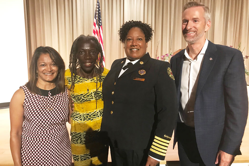 Multnomah County Commissioner Susheela Jayapal (left), Portland City Commissioner Jo Ann Hardesty, Portland Fire & Rescue Chief Sara Boone and Mayor Ted Wheeler pose at Boone's Aug. 12 swearing-in ceremony. Photo by Bernie Foster.