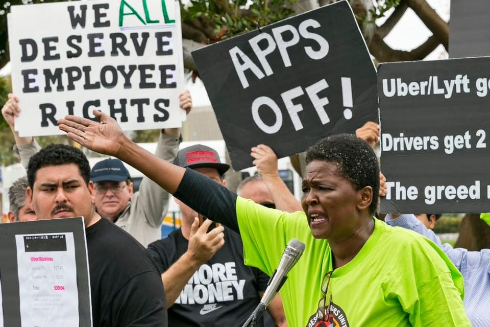 Uber and Lyft drivers protest their working conditions in Los Angeles in May 2019. AP Photo/Damian Dovarganes