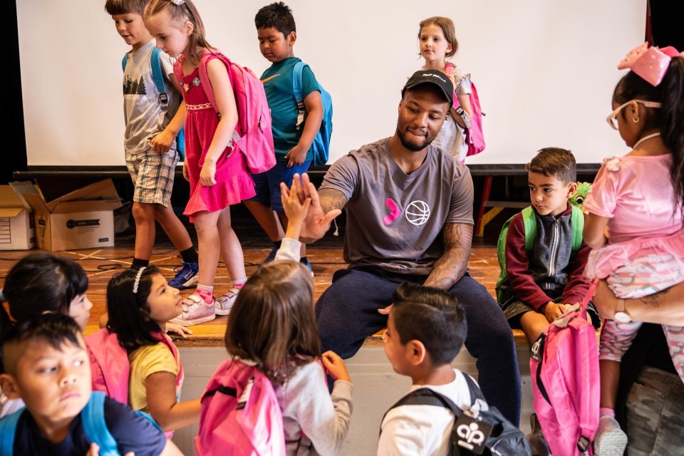 Portland Trail Blazers point guard Damian Lillard distributes backpacks filled with supplies on the first day of school. (Photo Courtesy: Portland Trail Blazers via GARD Communications)