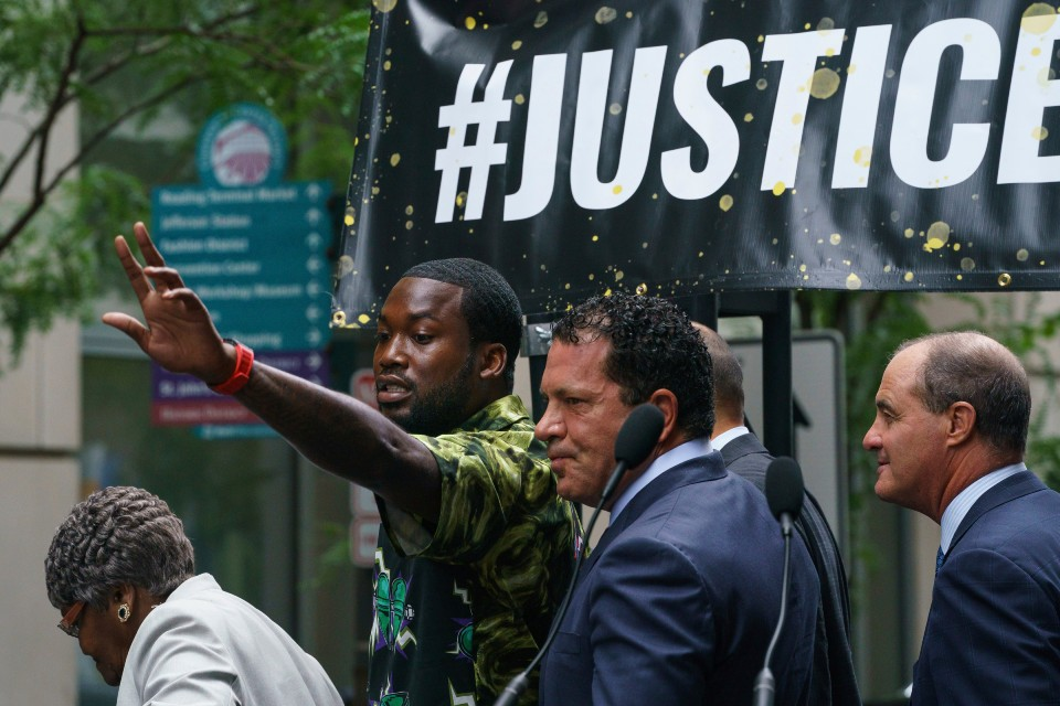 Rapper Meek Mill gestures at the crowd outside the Criminal Justice Center in Center City Philadelphia on Tuesday, Aug. 27, 2019. Mill pleaded guilty to a 2007 misdemeanor gun charge and won't serve additional time in prison after reaching a plea agreement in a case that's kept him on probation for most of his adult life. (Jessica Griffin/The Philadelphia Inquirer via AP)