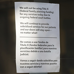 A sign is displayed on the door of Planned Parenthood of Utah Wednesday, Aug. 21, 2019, in Salt Lake City. About 39,000 people received treatment from Planned Parenthood of Utah in 2018 under a federal family planning program called Title X. The organization this week announced it is pulling out of the program rather than abide by a new Trump administration rule prohibiting clinics from referring women for abortions. (AP Photo/Rick Bowmer)